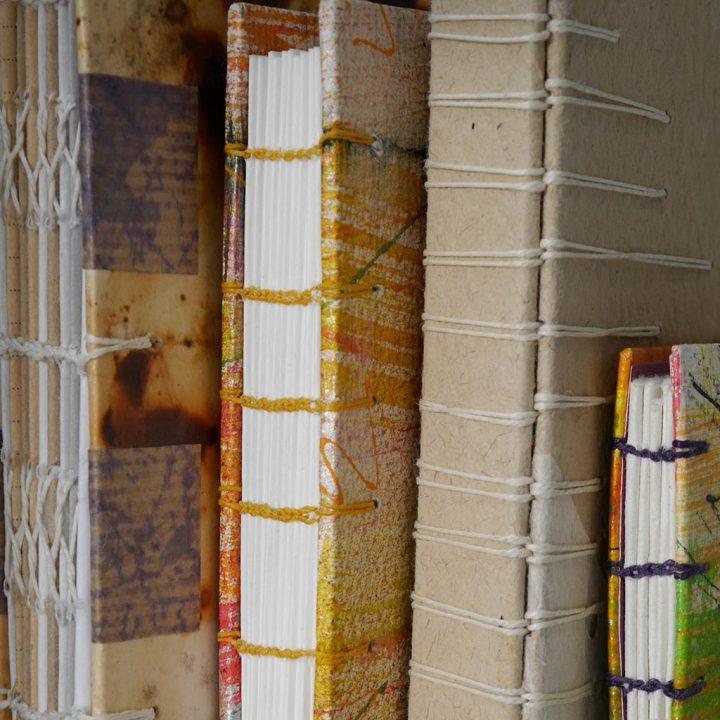 Exposed spine bindings