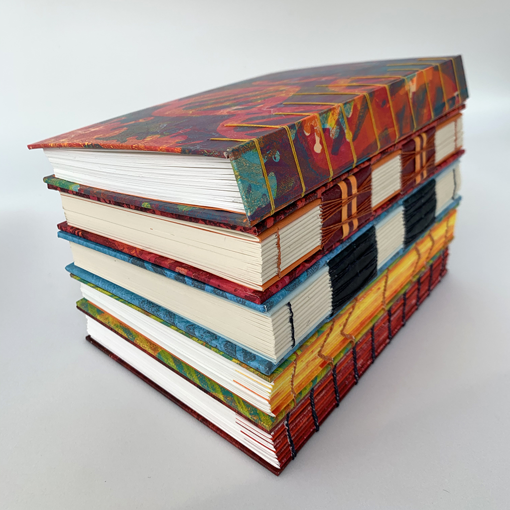 selection of books with exposed bindings